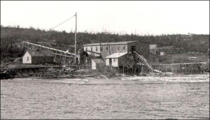 Early Mill at Botwood. This mill appears to be water powered because of the flume leading to it. (Photo Credit-Center for Newfoundland Studies Archives, Memorial University)