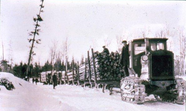 The Holt company became Caterpillar in 1925. Holt's were first used by the AND Company in the early 1920's. Here a 5 Ton Holt pulls a train of pulpwood.
