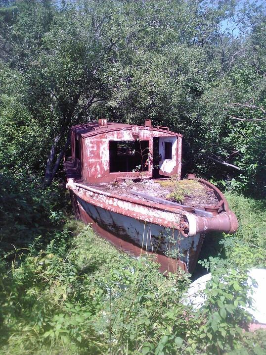 """Russell Brothers """"Steelcraft"""" winch boat. These boats were used to tow booms of pulpwood during the log drive (Photo courtesy of Glen Fewer)."""