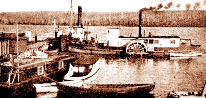 """Boats on Red Indian Lake Circa 1911. The Lady Mary at left, the Henry M to the right.  """"The Company"""" motorboat is centter left next to one of the scows used to transport men, horses and supplies  around the lake."""