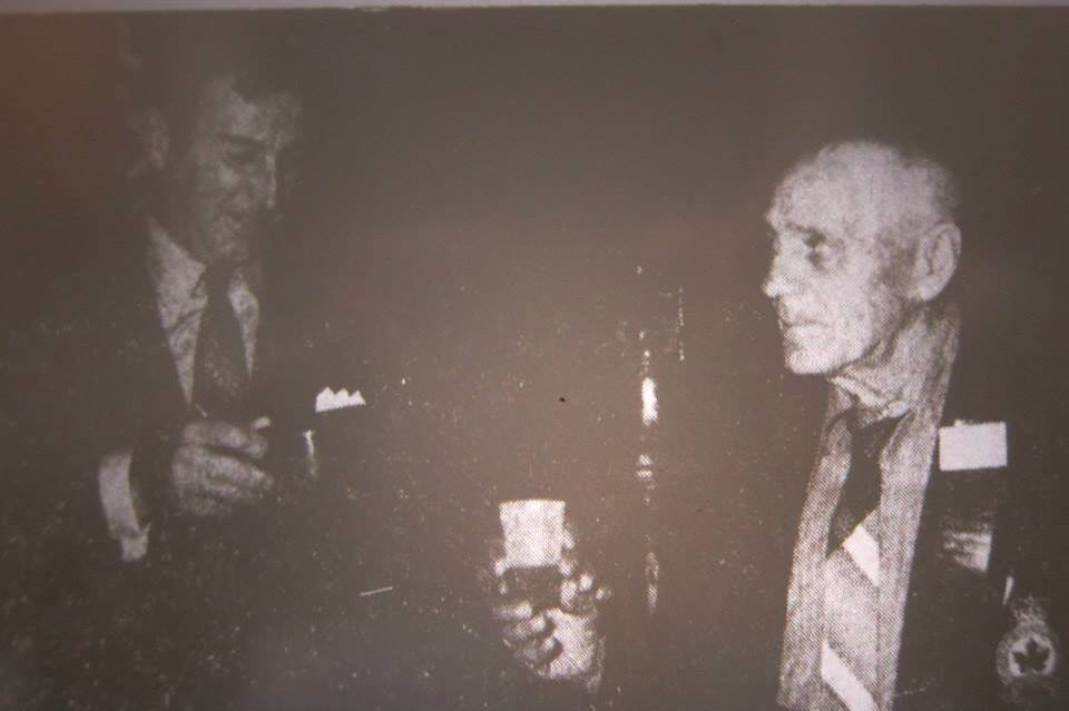 """Original Caption"""" """"Mr. Eliol Baker of Windsor was the first to get his tot of rum at the Central Newfoundland Naval Association reunion this past weekend."""" The next time he would be in the Advertiser would be twenty odd years later when the Legion needed to identify his picture from 1914. (Photo originally in the Grand Falls Advertiser 1968)"""