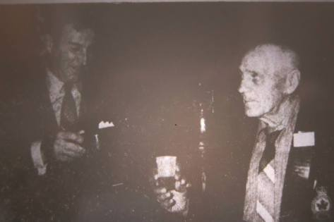 "Original Caption"" ""Mr. Eliol Baker of Windsor was the first to get his tot of rum at the Central Newfoundland Naval Association reunion this past weekend."" The next time he would be in the Advertiser would be twenty odd years later when the Legion needed to identify his picture from 1914. (Photo originally in the Grand Falls Advertiser 1968)"