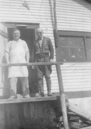 """Cook Joe Snow of Norris Arm was a well known figure who fed thousands of loggers over the years at the """"Depot."""" Here he is pictured with Divisional foreman George Stuckless one of the first Newfoundlanders to hold such a position. (Point Leamington Heritage Society)"""