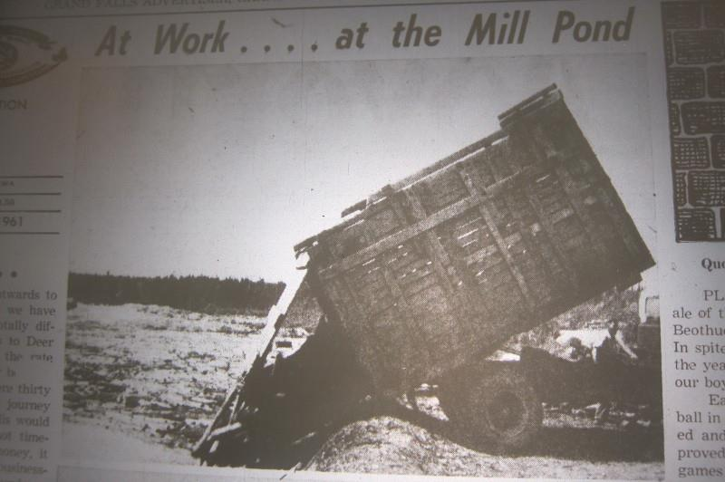 Wood from Bishop's Falls being dumped into the Grand Falls mill pond, circa 1955.