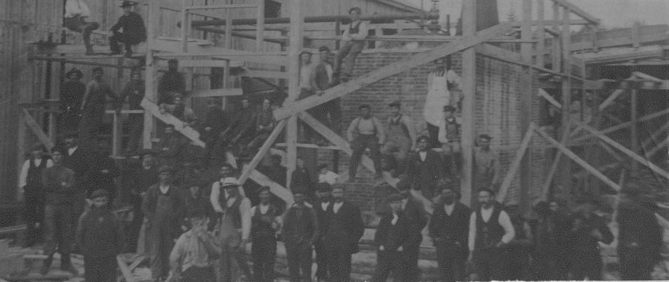 Harry Crowe and Newfoundland Pine and Pulp's steam lumber mill at Point Leamington circa 1907. Pine and pulp also operated mills at Botwood and for a time Badger. (PhotographerJames Andrews, Point Leamington Heritage Society)