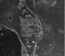 Part of Grand Falls in 1946. The large clered area at center is the site of the AND Co Dairy Farm-which operated there for more than 25 years after moving from Rushy Pond. (Photo fro Crown Lands Aerial Photo Library)