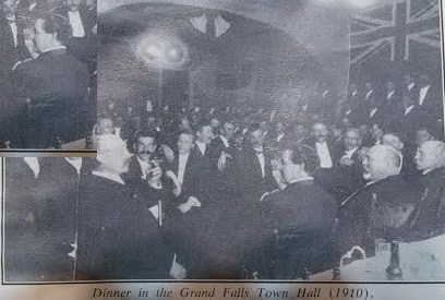 Photo of a dinner at the town Hall in Grand Falls 1910. The man third (and insert) from the right is reputedly Harry J. Crowe
