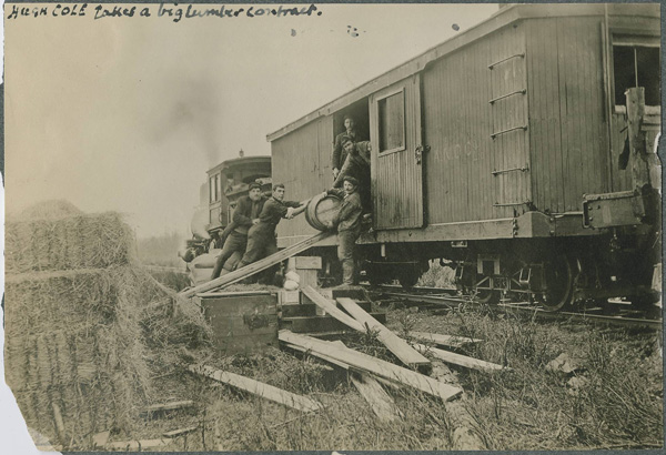 Hugh Cole takes a lumber contract. Offloading supplies for a logging camp around 1908 somewhere around Badger or Millertown. (Provincial Archives of NL)