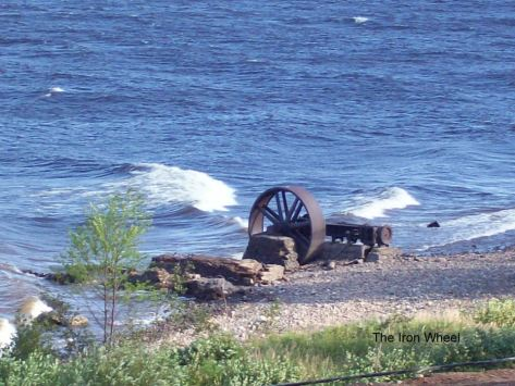 An iron fly wheel and piston cemented into a base is the largest piece that remains of what was once the largest sawmill in Newfoundland. Most of the other machinery was shipped to Grand Falls to be used in a sawmill there during mill construction in 1905. (Photo from Milertown Facebook page)