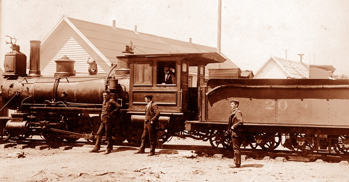 Lewis Miller had the Millertown Branch built by the Reid Newfoundland Company. He Also acquired one locomotive as well. Notice the unique hood ornament that has been affixed to this particular locomotive. (Red Indian Lake Heritage Society, Millertown 1900)