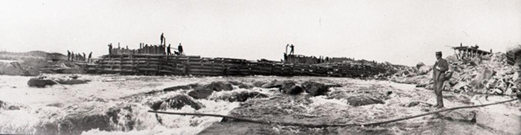 Lord Harmsworth surveys dam construction.