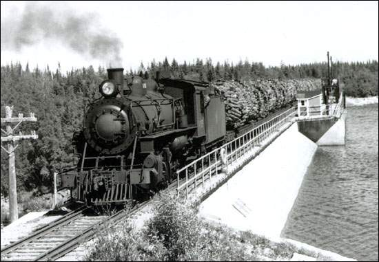 For around 30 years tens of thousands of cords of pulpwood a year were shipped from Terra Nova to Grand Falls via the Newfoundland and later CN Railway. This particular picture depicts a train load of Bowater wood going from Glenwood to Corner Brook but the sling loading set up of the wood is the same.