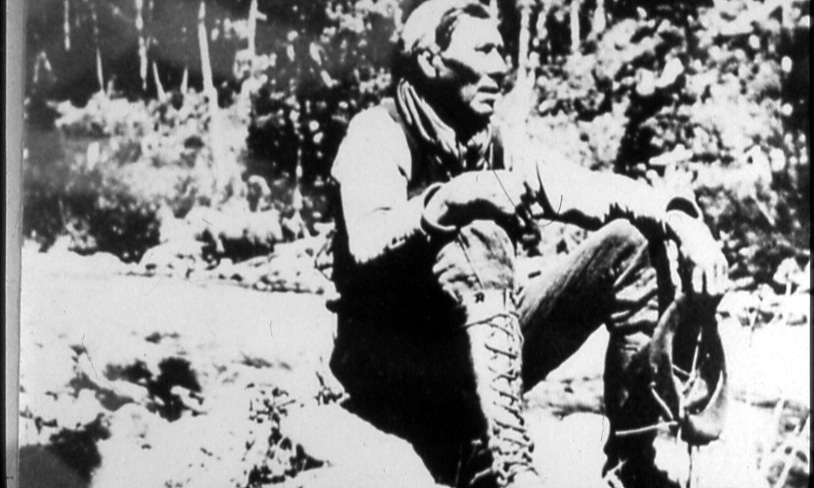 Matty Mitchell, native trapper and prospector. The old legend says that Matty discovered the Buchan's deposit when he noticed the rocks around his camp fire had melted.