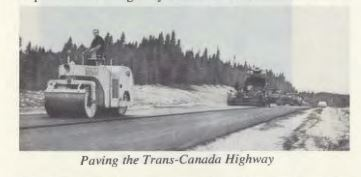 Finishing the Drive by 65. Paving the Trans-Canada. (Encyclopedia of Newfoundland).